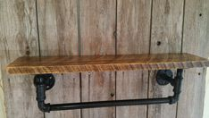 Industrial Steel pipe bath towel rack with reclaimed wood shelf. approx 24x9x6 We can customize size and colors to your taste. Color selection is you option on pipes and wood. Making this a nice addition to any decor. Please contact us and let us get one going for you.