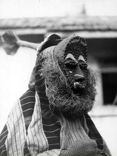 Africa | A Bété masquerader dances in Grand-Bassam, South Comoé region, Ivory Coast | 1963 | Photographer André P Schaller
