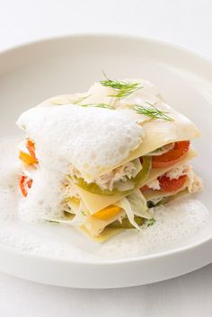 This open lasagne recipe has a wonderful light flavour from delicate crab meat, sweet, slow-roasted tomatoes and fragrant fennel, layered together with pasta.