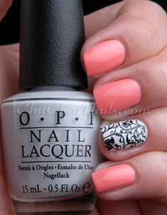 Love the combination! peach/coral nails with black and white accent nail.