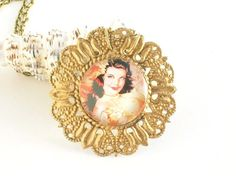 Ornate Judy  Garland Necklace with gold leaf gilding.