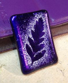 Powdered glass sprinkled on dichroic with a real leaf stencil