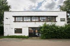 Asterdwarsweg 10, poortgebouw van het voormalige Asterdorp. Oud atelier van kunstenaar André Volten Foto: Janus van den Eijnden