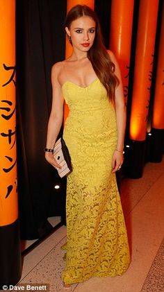 Ladies in lace: Xenia Tchoumitcheva hot-footed it from the Kong premiere to the bash, stil...