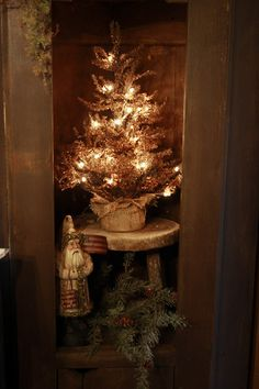Prim Lighted Pine...tree wrapped in burlap...with belsnickle & pine.