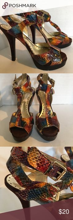 "BCBGirls Stunning Leather High Heels Stunning leather high heels with double buckle straps multi colored snake skin texture with suede heels in great condition very little wear on soles. 4"" heel. Gorgeous shoes! BCBGirls Shoes Heels"