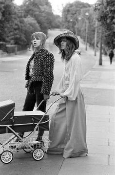 """June Mr and Mrs Bowie take three-week-old Zowie for a walk."""" Before we make fun of Kanye and Kim again, can we just absorb the idea that David and his wife named their daughter Zowie Bowie? Angie Bowie, Monsieur Madame, The Thin White Duke, Ziggy Stardust, Herzog, Brixton, Belle Photo, Look Fashion, Rock And Roll"""
