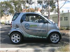 Green Plumber's AutoSkin, Vehicle Wrap, Smart Car Wrap