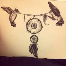 How cute would this be on your back?! The birds would be across your shoulders and the dream catcher hanging down your back. I LOVE IT
