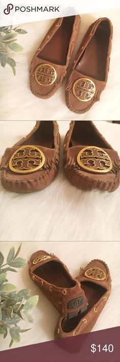 Tory Burch Suede Alexandria Fringe Moccasins EUC Tory Burch suede tan/camel colored moccasins. Fringe detailing underneath gorgeous TB rose gold colored emblems on each shoe. Leather insole -Rubberized bottom soles for grip and comfort. Slight natural rubbing on bottom soles as shown in pictures. Retails for $275 new. Tory Burch Shoes Moccasins