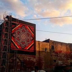 """Shepard Fairey  """"Thanks @danibirn for sharing this sunset shot from Philadelphia. #obeygiant #shepardfairey #mural"""" 7/21/15"""
