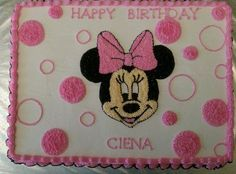 Minnie Mouse Yellow cake with whipped butter cream icing and edible glitter