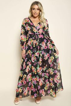 1bba5042344a9 A plus size maxi dress with a surplice V-neckline and long sleeves. Features