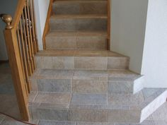 Tiled Stairs  rustic wood railing at http://awoodrailing.com