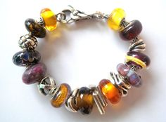 Warm plum and honey golds make this Trollbeads bracelet design by Tartooful absolutely delicious...