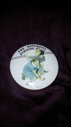 Check out this item in my Etsy shop https://www.etsy.com/listing/218779270/marbles-champion-by-norman-rockwell