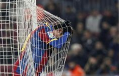 Barcelona's soccer player Lionel Messi reacts after missing an opportunity to score against Almeria during their Spanish King's Cup semi-final soccer match at Camp Nou stadium in Barcelona January 26, 2011.  REUTERS/Albert Gea