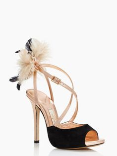 Love the feather detail on these peep toes