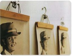 Using vintage wooden pants hangers is a simple, clever, and inexpensive alternative to framing your prints and photographs.