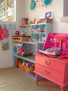 fun little play space. And that's a nightstand there! I love when people use furniture for fun stuff!