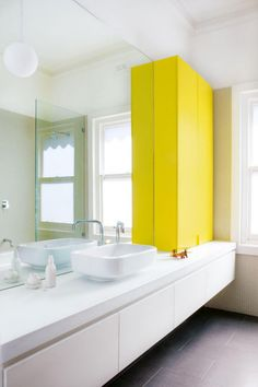 bright | yellow | white | grey | mixed texture | floating vanity | penny tile | bright light | vessel sink | family bathroom | full mirror