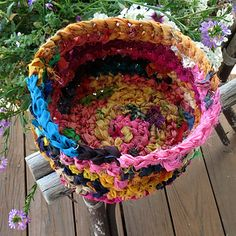 free pattern for a sari ribbon nesting bowl by playingwithfiber on ravelry. Could also be made with t-shirt yarn or plarn (includes link to how to make plarn). Amazing idea