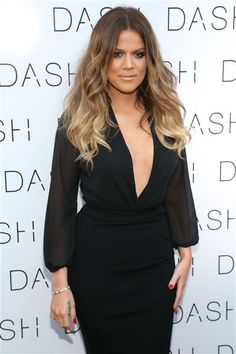 Khloe Kardashian arrives at the DASH store opening in Miami on March 12, 2014.