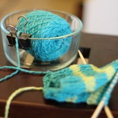 Yarn Bowl  - just a binder clip and heavy bowl, so yarn won't go rolling around the floor.