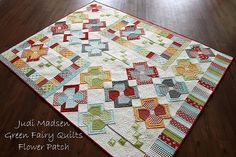 Flower Patch QAL Quilt Finished. This is another stunning quilt by Judy at Green Fairy Quilts. Her work is incredible.