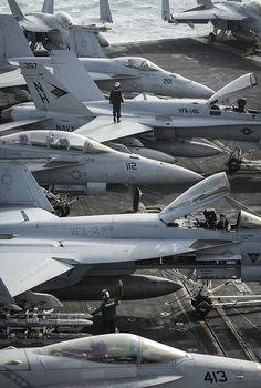 Sailors prepare aircraft for flight operations on the flight deck of the aircraft carrier USS Nimitz (CVN 68).