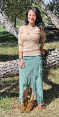 This Turquoise Cowhide suede skirt is one of the most sexy and unusual Western Skirts that we have come across. The hem is uneven and is decorated with hand cut fringe all along the hem. It closes with a zipper. This is a great skirt to wear with its own matching Western Shawls or Western Vests and Jackets. It will also look great with a Western T-shirt for a casual look or even a Western Denim Jacket. Try it with one of our Western Embroidered shirts with a Western belt with conchos or ...