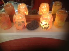 Easy Halloween Lights: color kitchen paper with foodcoloring, dry in the oven, paste shilouettes on glas jars and cover them with pieces of the paper.