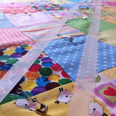 Tips on how to make a patchwork quilt. Use masking tape to help sew straight lines
