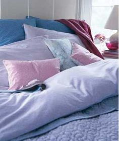 Bed with lavender bedding
