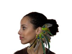 Hey, I found this really awesome Etsy listing at http://www.etsy.com/listing/160464935/feather-ear-cuff-feather-earring-boho