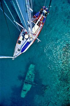 sailing - notice the remains of a plane below the water