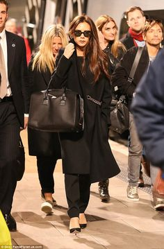 Victoria Beckham arrives at Manchester Piccadilly station, ahead of launching her fashion concession at Selfridges. (November 2014)