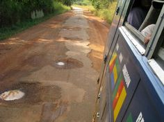 Heading east in Guinea Bissau, the paved highway gradually starts to deteriorate as we head into the Guinean highlands. One side of Aminah on the tar and one on the dirt! Great shot from passenger Holly Melanson on our Overlanding West Africa trip