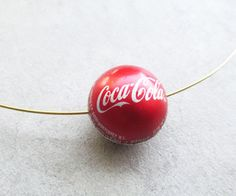 Excellent video on How to make a bottle cap bead.