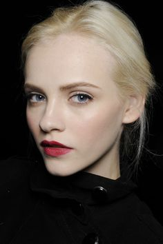 Stained red lips and classic subtle liner at Dolce and Gabbana Autumn/Winter 2010-11. Makeup by Pat McGrath.