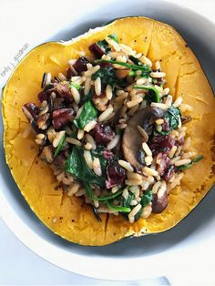 Sweet roasted squash stuffed with a hearty wild rice, mushroom, and cranberry filling this dish warms you from the inside out on a cool fall night.
