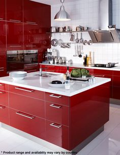 red kitchen -  I like the drawers instead of cabinets and the high gloss finish, but I imagine they are a bitch to keep fingerprint free.