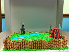 Dinosaur Cake - love the wafers around the cake!