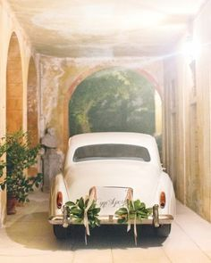 "A vintage Silver Cloud Rolls-Royce, bearing a ""married today!"" sign in Italian, made for a romantic getaway back to the Villa d'Este, where John and Chrissy stayed."