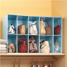 Shelving for purses! I so need this!! I also need it to be larger and strong enough to hold the weight of small children (since that's about how heavy my purses are).