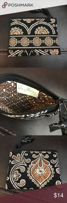 Vera Bradley Cafe Latte coin wallet 💗 Vera Bradley Cafe Latte coin wallet 💗 This is my mother in laws & I don't know much about Vera but I think it's Cafe Latte pattern. Seems to be in like new condition! Vera Bradley Bags Wallets