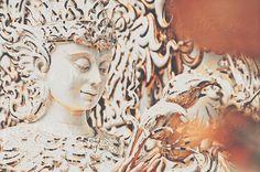 Srdjan Kirtic for Stocksy United - Exquisite design detail of a meditative deity-like statue carved inside the White temple in Thailand.  architecture, artistic, asia, buddha, buddhism, calm, carved, deity, design, east, exquisite, extravagant, glitter, harmony, hindu, holy, inner, intricate, lavish, meditation, nirwana, peaceful, portrait, prayer, pura, religious, sacred, sculpture, serene, spirit, spiritual, statue, stone, stress free, temple, wat rong khun, yoga, zen