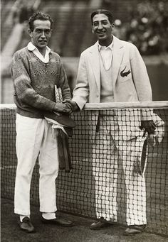 When French tennis players Henri Cochet and René Lacoste met at the net in this undated photo, Lacoste was sporting his signature crocodile on his blazer. © Underwood & Underwood/Corbis