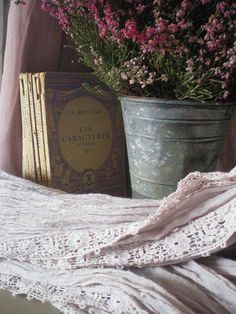 Lovely and charming cottage decor----lavender linens, flowers and books!