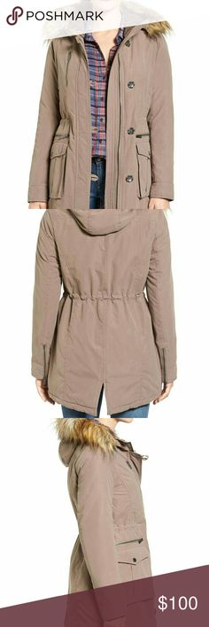 Rachel Roy Faux Fur Trim olive Army Parka Small A cold-weather parka with a military-utility vibe and faux-coyote-fur trim offers an extra dash of coziness with neck-warming fleece lining the hood.  Front zip closure with button-loop outer placket Attached hood with detachable faux fur Long sleeves with zip cuffs Front bellows and zip pockets, including chest pocket Back slit Water repellent Lined, with polyester fill 100% polyester; 100% acrylic faux fur  Worn once. Olive color. The last…